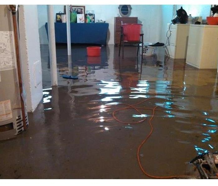 basement flooded with water Vincennes Indiana SERVPRO is here to help